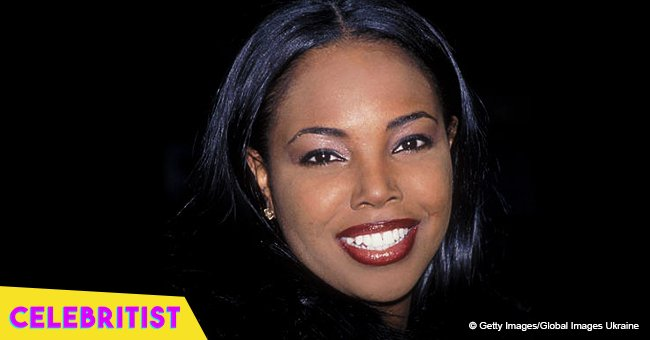 Kellie S. Williams stuns in lace jacket and black fishnet tights in sizzling throwback photo